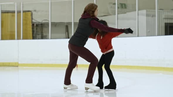 Thumbnail for Professional Athlete Practicing Figure Skating with Girl