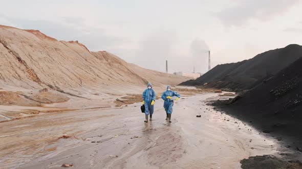 Ecology Experts Walking Along Polluted City