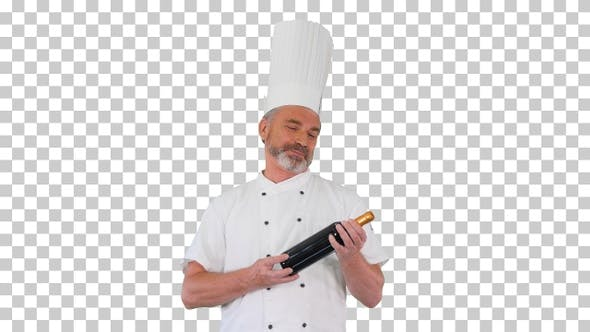 Senior chef holding a bottle of perfect, Alpha Channel