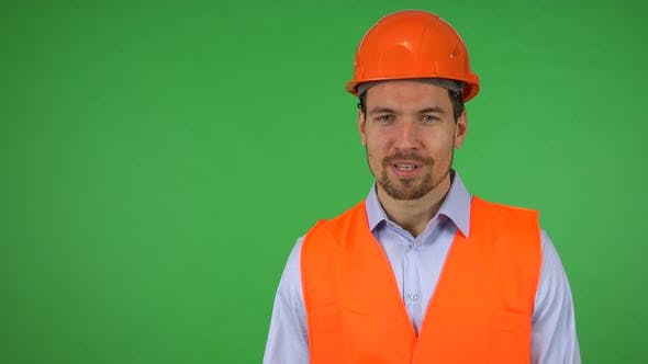Thumbnail for A Young Construction Worker Talks To the Camera About the Construction Around Him - Green Screen