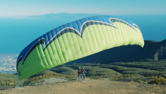 Cover Image for Paraglider, Flying Over Sea. Starting To Take Off, Break Away From the Ground.