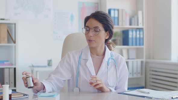 Portrait of Female Doctor Giving Consultation