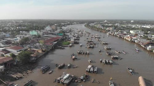 Aerial: flying over Cai Rang floating market in the morning, Can Tho, Vietnam
