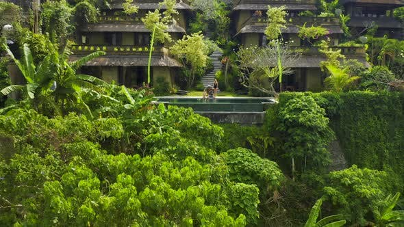 Thumbnail for Happy Family Sitting on the Edge of the Infinity Pool in a Tropical Paradise in Ubud, Bali