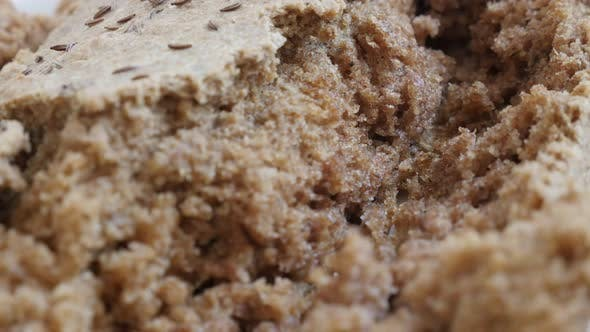 Tilting over rustic bread crust with full healthy grain and barley  4K 2160p 30fps UltraHD footage -