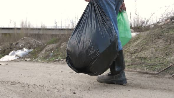 Thumbnail for Male Legs in Boots Walking at Garbage Dump