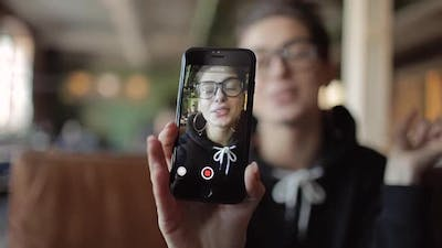 Young Vlogger Recording Video for Social Network