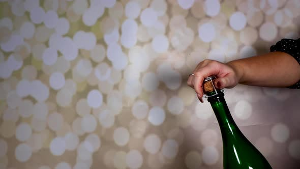 A champagne bottle being opened and popping out and flying across the room