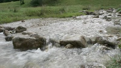 Hand Held Footage of River in the Mountain