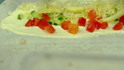 CU Slow Motion Cook Prepares a Wok with Fresh Vegetables Adds Cheese