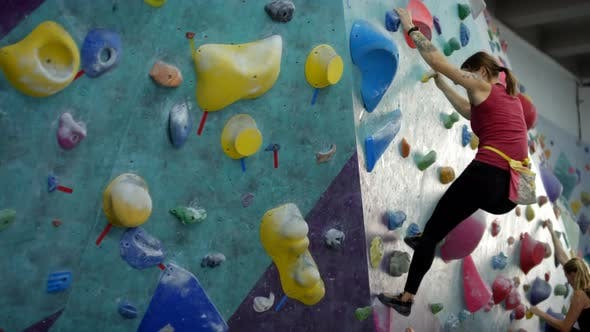 Thumbnail for Two Women Bouldering at Climbing Gym