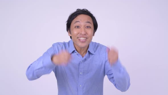 Thumbnail for Happy Japanese Businessman Looking Excited with Fists Raised