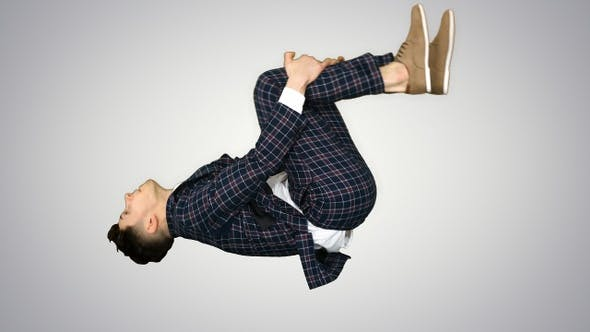 Thumbnail for Businessman makes a back flip and shows cool gesture to