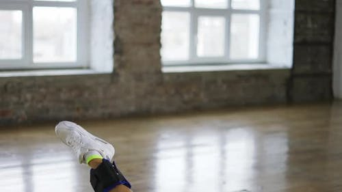 Unrecognizable Woman Doing Stretching Exercise with Ankle Weights Close Up