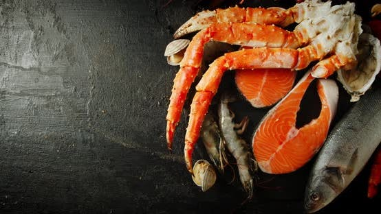 Thumbnail for Fresh Seafood on the Table. On a Black Background.