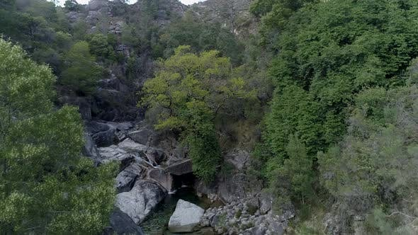 Thumbnail for Flight Over the Rocky Canyon and Creek