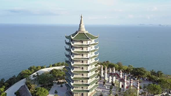 Thumbnail for Aerial View Buddhist Temple Pagoda with Gate on Coastal Edge