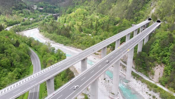 Cover Image for Aerial View of the Concrete Highway Viaduct on Concrete Pillars in the Mountains