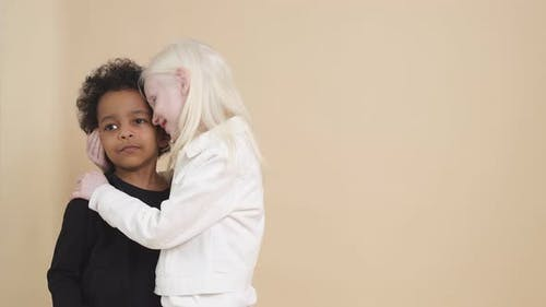 Lovely Sensual Albino Girl Going To Kiss Mulatto Boy