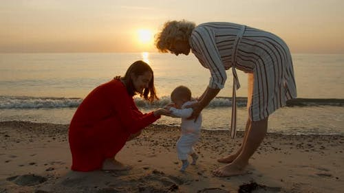 Mom and Grandmother Teach the Child To Walk