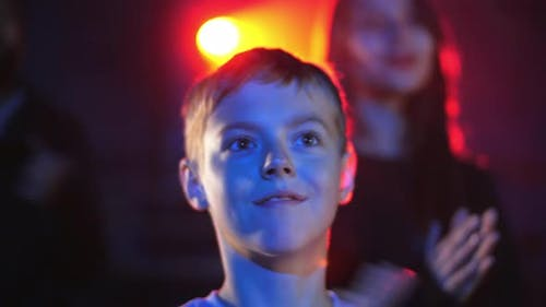 Kid at Music Concert Enjoying with Parents and Clap Hands with Impressions