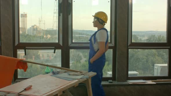 Thumbnail for Young Worker on Construction Site Looking at City