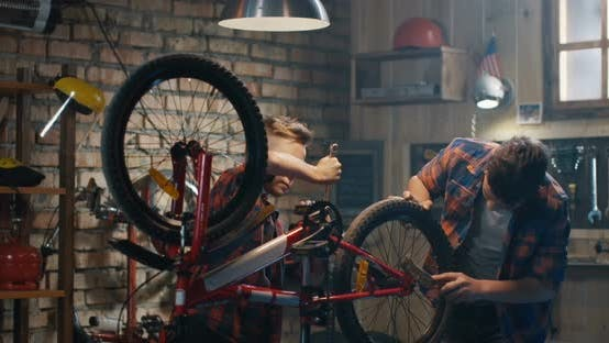 Thumbnail for Two Boys Repairing a Bike in a Garage