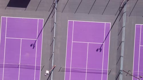 Drone Flying Over Bright Colored Tennis Courts