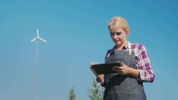 Thumbnail for Woman Farmer Checks the Production of Electricity By a Home Wind Turbine