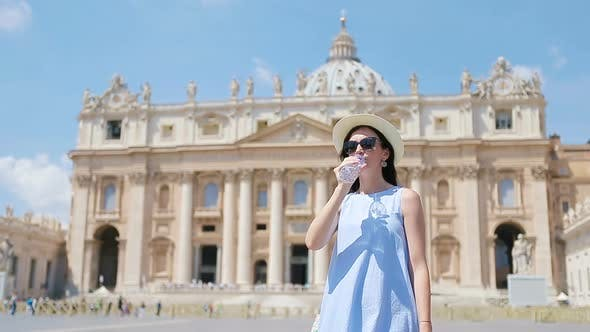 Thumbnail for Young Woman Drinking Water Background at St. Peter's Basilica Church in Vatican City, Rome, Italy.