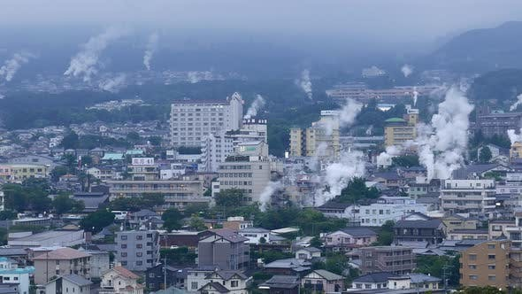 Beppu city, Japan cityscape with hot spring bath houses and rising steam