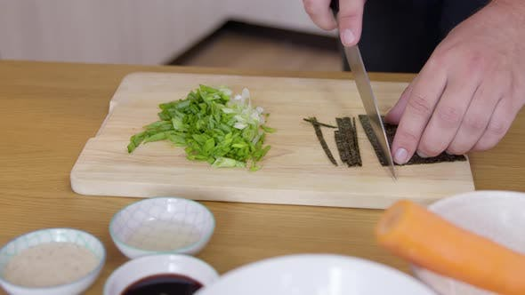 Close Up Male Cook Cuts Nori Dry Seaweed Sheet, Ingredients of Wholesome Meal