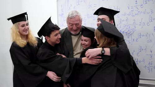 Graduates Hug with Their Professor in University