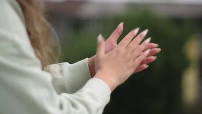 Woman Clapping on the Balcony