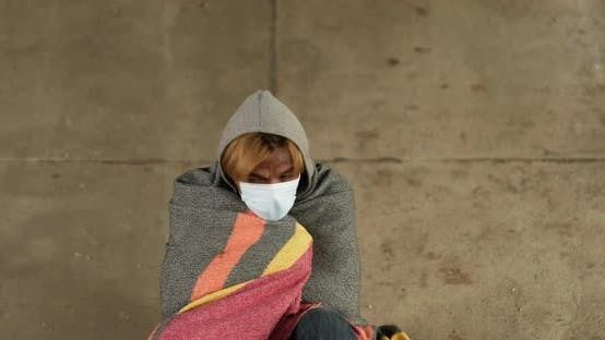 Homeless man feeling cold.