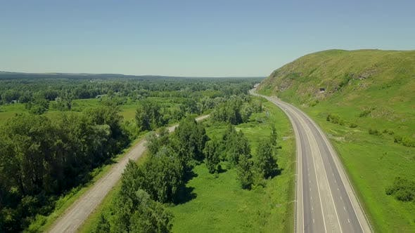 Thumbnail for Aerial: Flying Vertically Upward, Above the Highway, in Mountainous Area