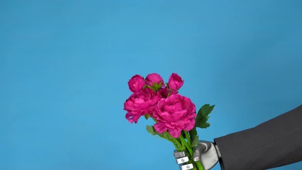 Cyborg Businessman in a Suit with a Bouquet of Roses. Gray Mechanical Hand Holds a Bouquet of
