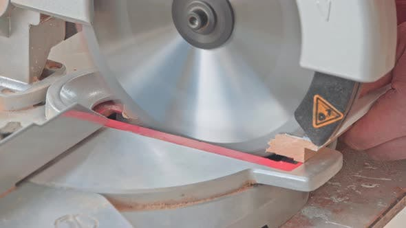 Thumbnail for Carpenter Using Circular Saw for Cutting Wooden Boards