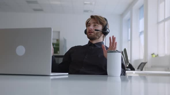 Office Worker Does His Online Work in Office