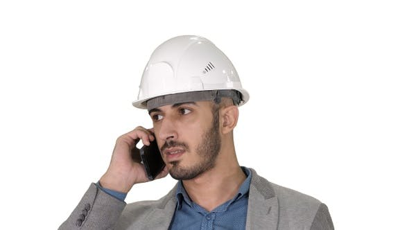 Thumbnail for Engineer talking a mobile phone inspecting construction