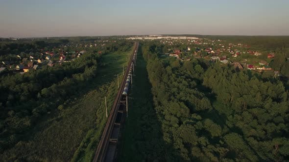 Cover Image for Train Running in the Village, Aerial View