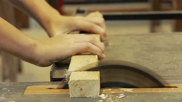 Thumbnail for Student is Cutting a Piece of Wood with Electric Circular Saw in Carpentry Workshop.