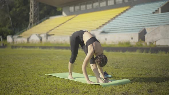 Thumbnail for Wide Shot of Flexible Young Woman Standing in Yoga Pose on Exercise Mat. Portrait of Beautiful Slim