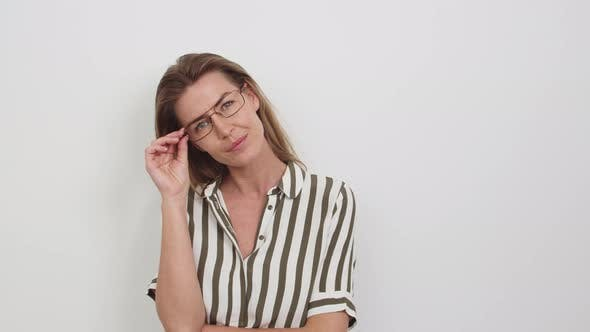 Thumbnail for Woman in Striped Top and Glasses