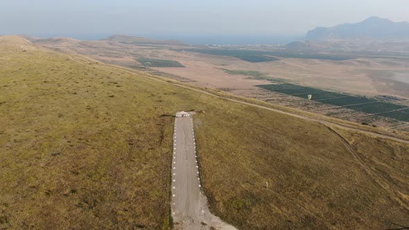 Thumbnail for Hang Gliders Take Off From the Runway in the Mountains Above the Valley with a Dried Lake and