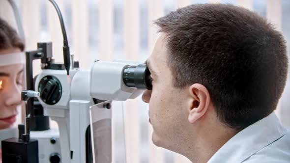 Thumbnail for Ophthalmologist  Checking  Eyesight of a  Woman Using Device