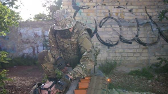 Ranger Dragging Away Fallen Soldier From Combat