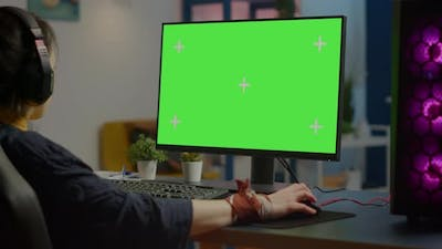Woman Streaming Online Video Games on Powerful Computer with Green Screen