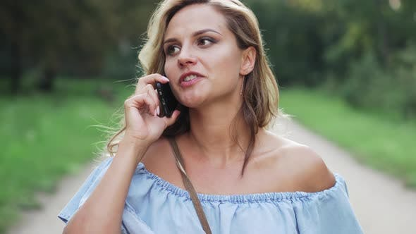 Angry Blonde Talking on Phone