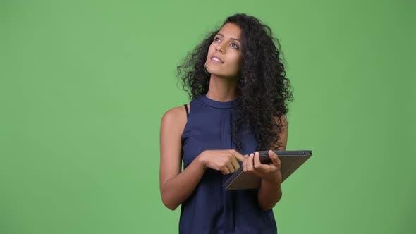 Thumbnail for Young Beautiful Hispanic Businesswoman Using Digital Tablet